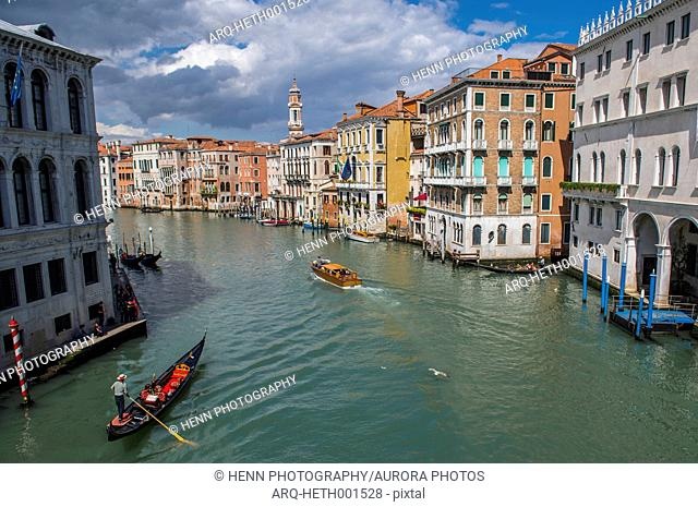 View of Grand Canal with gondola and motorboat, Venice, Italy