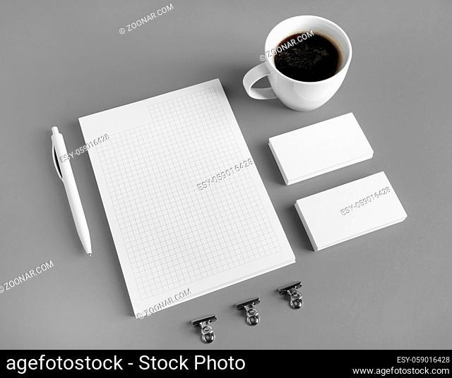 Photo of blank stationery set on gray paper background. Branding mock up