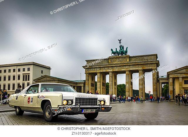 Old 1970s Cadillac parked near the Brandenburg Gate in Berlin, Germany