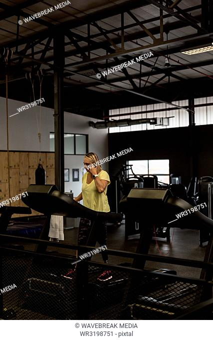 Woman exercising on treadmill in the gym