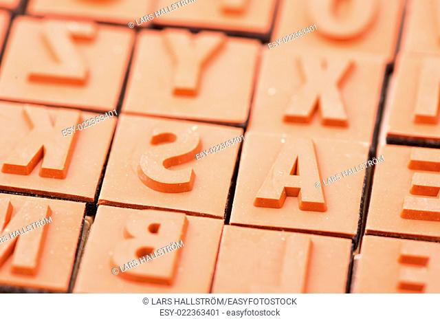 Close up of red rubber stamp letters