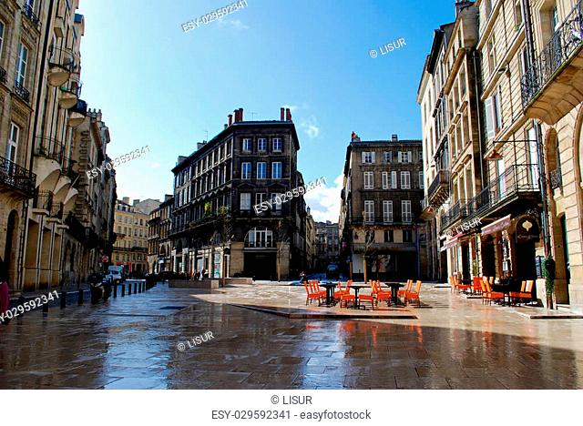 Bordeaux square with cafe and buildings in winter