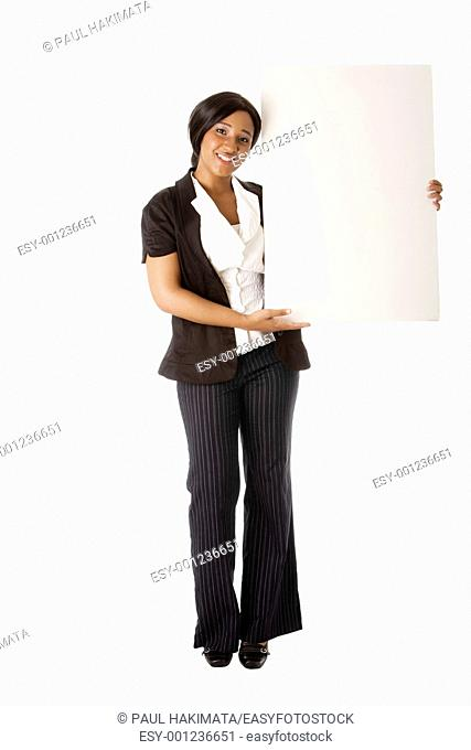 Beautiful smiling successful corporate business woman pitching an idea presenting blank whiteboard, isolated