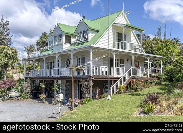 traditional wooden house at touristic village, shot in bright late spring at Tairua, Coromandel, North Island, New Zealand