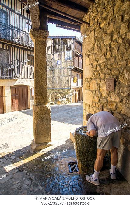 Man drinking water at a fountain. Mogarraz, Sierra de Francia Nature Reserve, Salamanca province, Castilla Leon, Spain