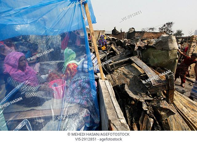 Bangladeshi slum People living under the open sky after a fire in Korail Slum in Dhaka on March 17, 2017. Bangladeshi fire service officials reported that over...