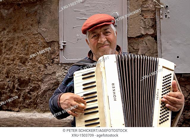 street musician with accordion in Rome, Italy