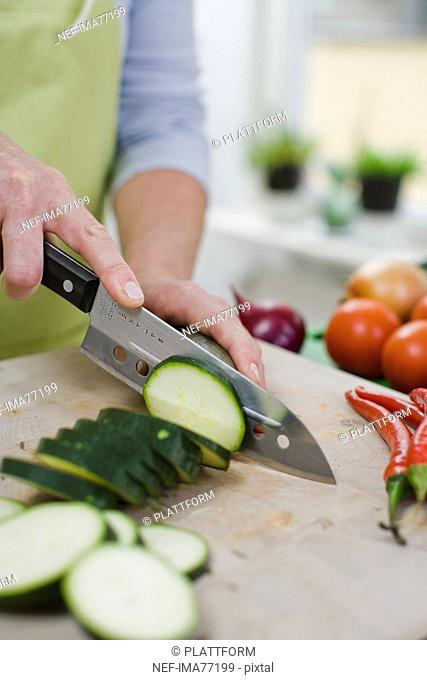 Woman cutting up vegetables, Sweden