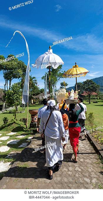 Procession of devout Buddhists with offerings, at Pura Ulun Danu Bratan water temple, Lake Bratan, Bali, Indonesia