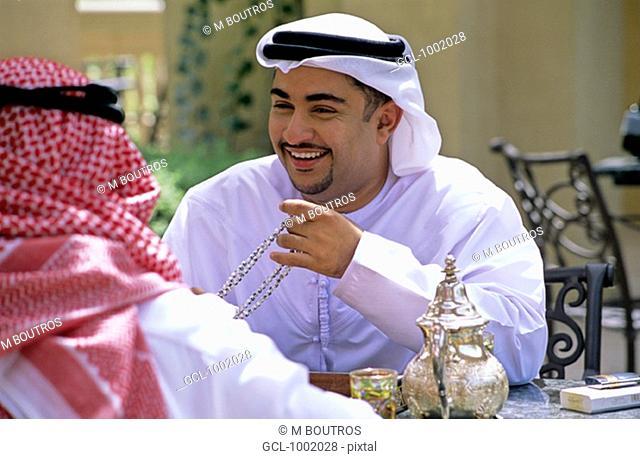 Arab men enjoying tea and backgammon