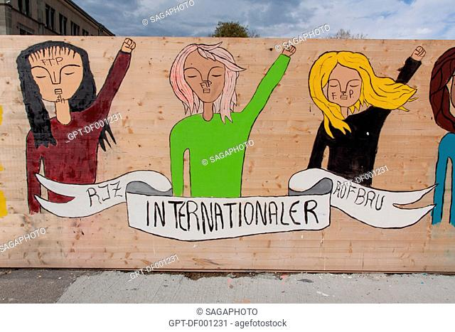 GRAFFITI WITH THE DEMANDS ON THE INTERNATIONAL FEMINIST MOVEMENT ON THE FENCE AROUND A CONSTRUCTION SITE IN THE CENTER OF ZURICH, CANTON OF ZURICH, SWITZERLAND