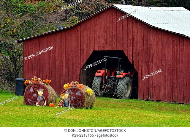 A barn with decorated hay rolls, Townsend, Tennessee, USA