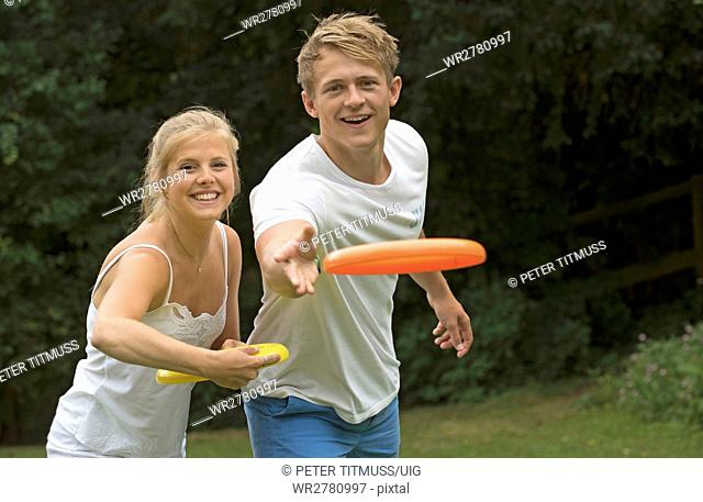 Young couple playing a flying disc game