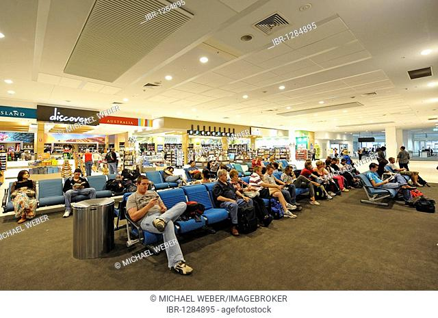 Stores and passengers at an airport gate, waiting area, Brisbane International Airport, Brisbane, Queensland, Australia