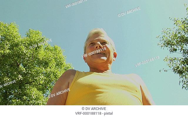 An older man flexes his muscles