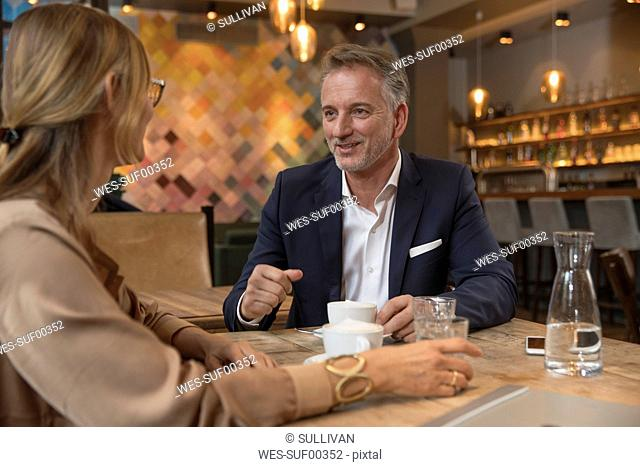 Two business people having meeting in a restaurant