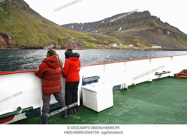 Norway, Svalbard, Spitzberg island, Isfjord; tourists on a boat