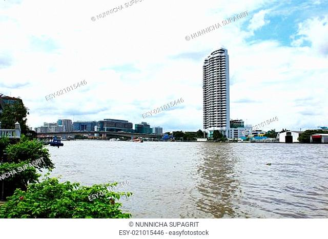 Buildings along the river. The view from Santi Chai Prakan Park. Attractions in Bangkok, Thailand