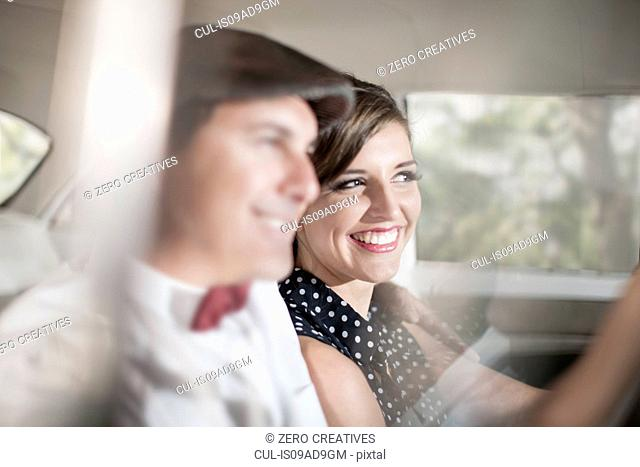 Close up of couple in vintage car