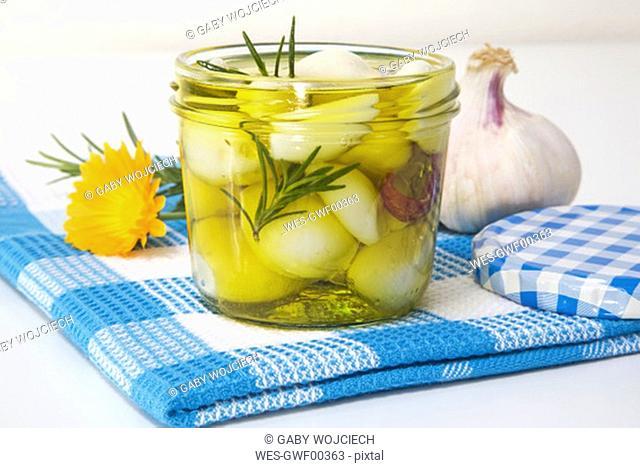 Homemade pickled garlic, close-up