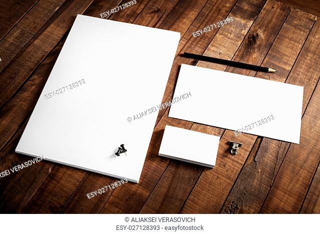 Blank stationery set on wood table background. Corporate identity template. Letterhead, business cards, envelope and pencil