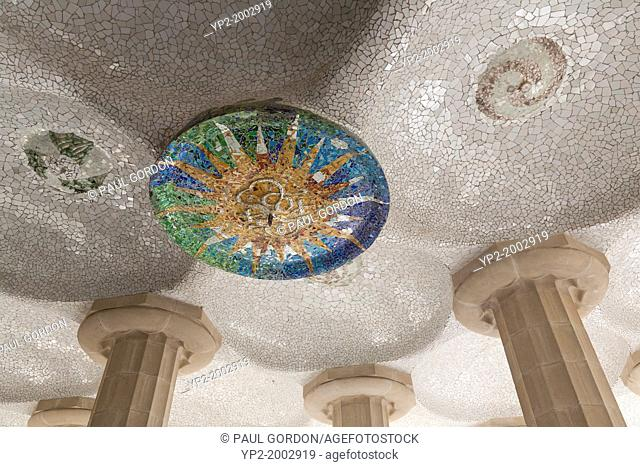 Mosaic medallion in the Hypostyle Room in Park Güell - Gràcia, Barcelona, Catalonia, Spain. The hypostyle room, which supports the famous serpentine bench above