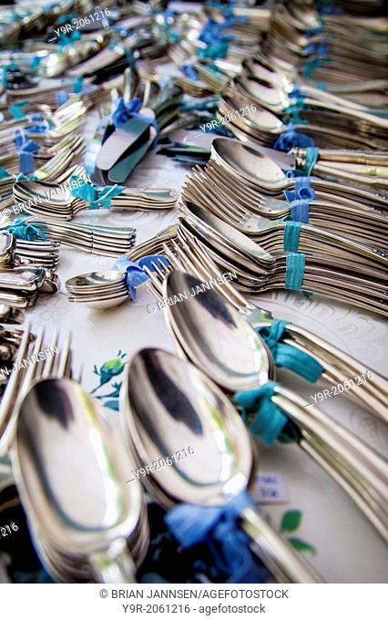 Antique silverware for sale at a flea market in the Marais District of Paris, France