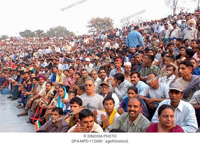 Huge crowd gathered to watch parade during closing of border gates at Wagah border about 30 kms away from Amritsar ; Punjab ; India