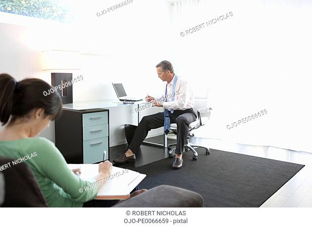 Father and daughter in home office