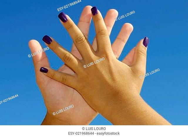 Hands touching in a romantic way