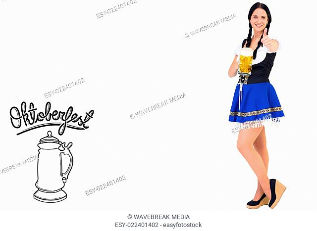 Composite image of pretty oktoberfest girl holding beer tankard