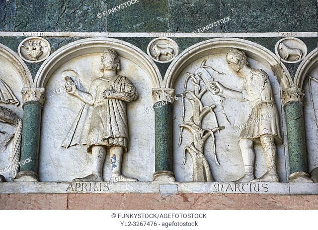 Late medieval relief sculpture depicting the labours for March and April and astrological signs on the Facade of the Cattedrale di San Martino, Duomo of Lucca