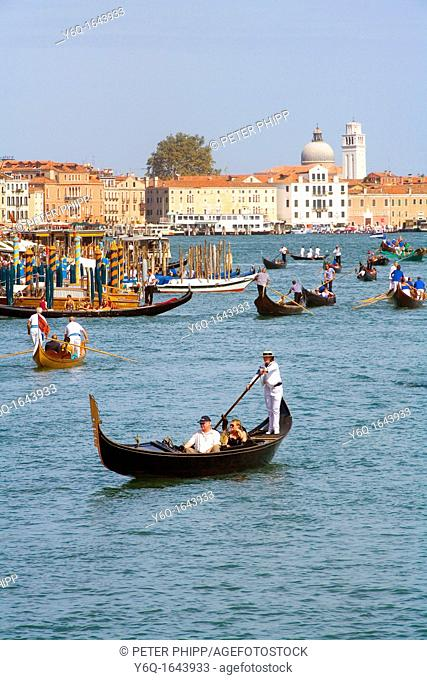 People riding in Gondolas near the Grand Canal in Venice