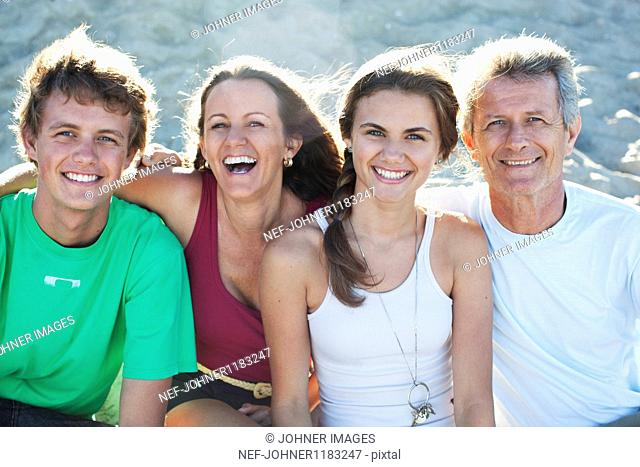 Parents with children on beach