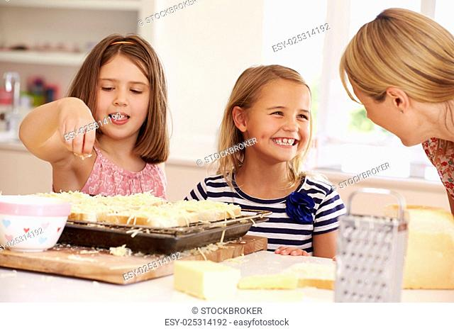 Girls With Mother Making Cheese On Toast