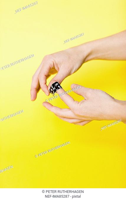 Person putting on band aid