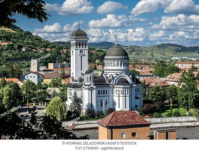 Romanian Orthodox Holy Trinity Church - view from hill of Historic Centre of Sighisoara city, Transylvania region in Romania