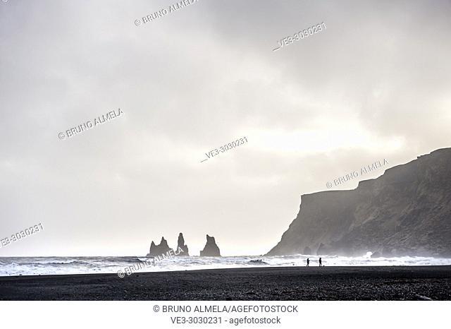 View of Reynisdrangar rocks from black sands beach in Vík (region of Suðurland, Iceland)