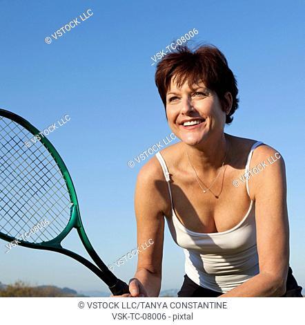USA, California, San Francisco, Mature woman playing tennis