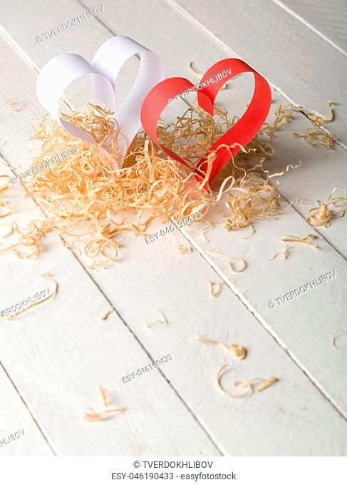 Postcard to Valentine's Day. White and red heart made of paper strips. White background. Country for text