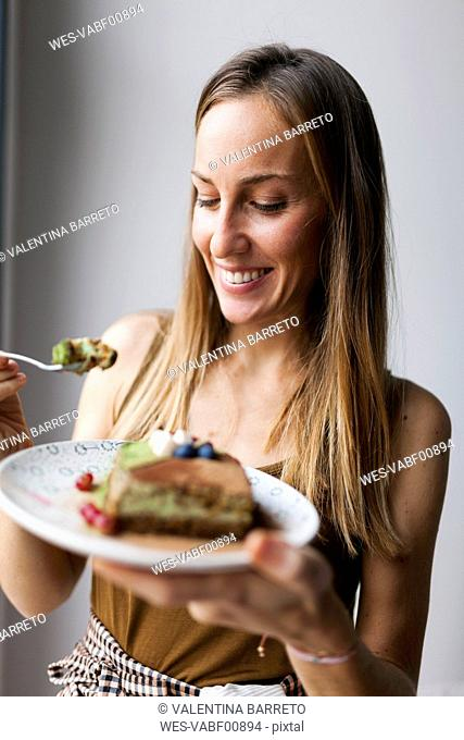 Woman eating vegan matcha cake