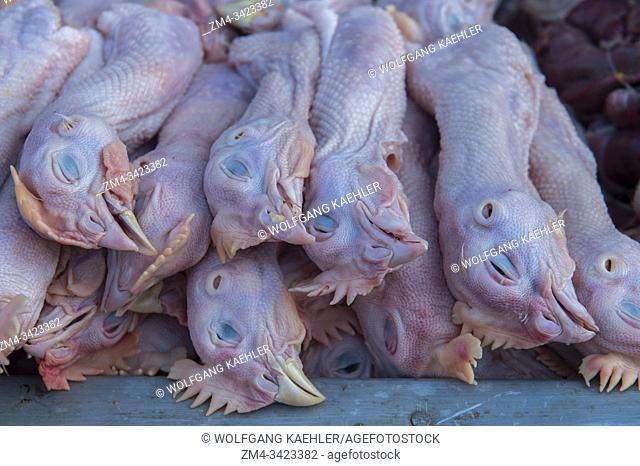 Fresh slaughtered chicken heads for sale at the daily morning street market in Yogyakarta in Java in Indonesia