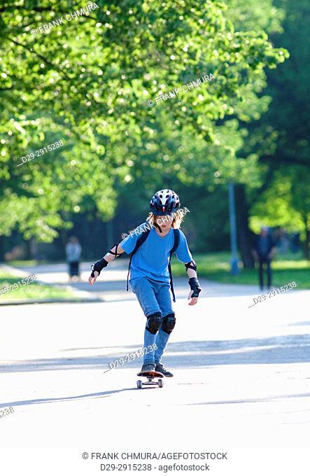 Skateboarding - Boy with Blond Hair Learning to Skateboard.