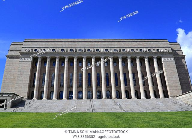 The Parliament House, Helsinki, Finland. The building designed by Johan Siren has exterior of red Kalvola granite and includes 14 Corinthian columns