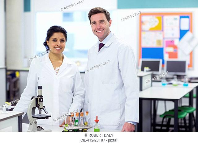 Portrait of two smiling teachers in chemistry lab