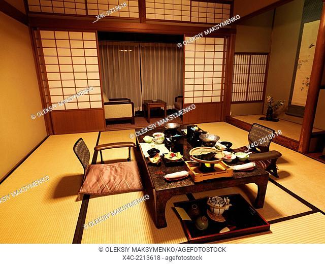 Japanese traditional ryokan hotel room with dinner on a table. Gero, Gifu, Japan