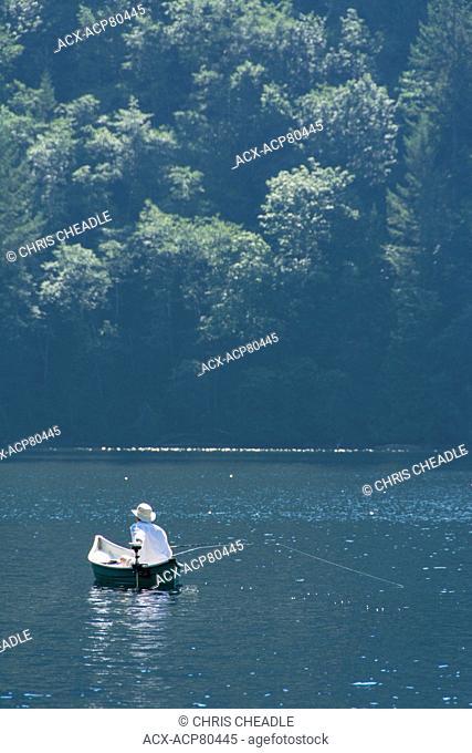 Man canoe fishing on Klein Lake near Egmont, , Sunshine Coast, British Columbia, CanadaBritish Columbia, Canada