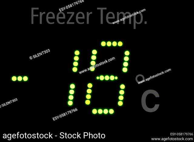 Close up of a freeze indicator showing -18 degrees in green led letters