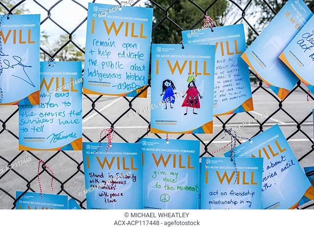'I will' promissory notes attatched to fence. Walk for Reconciliation, Vancouver, British Columbia, Canada