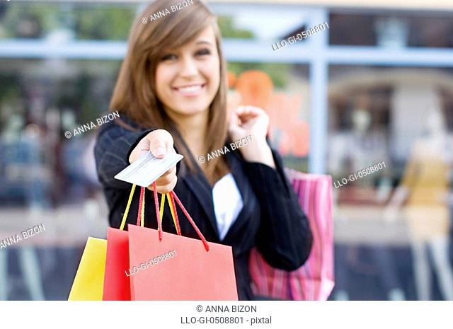 Young woman with shopping bags and credit card Debica, Poland